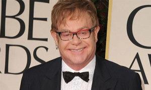 Elton John hủy diễn vì ngộ độc thức ăn