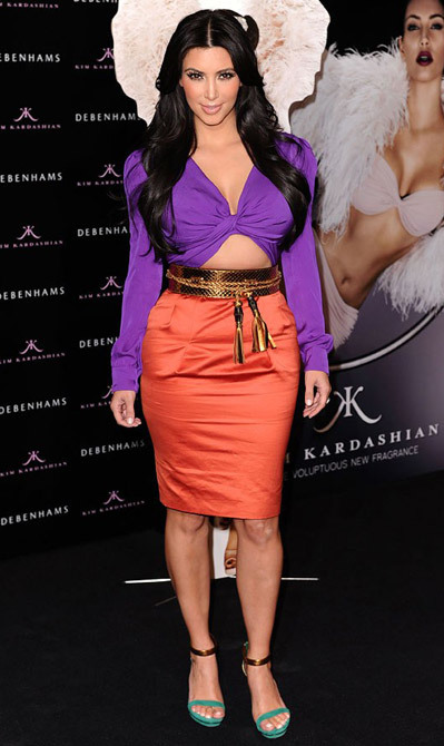 The very next day, Kim shook off the formality of the night before to flash a sliver of tum, courtesy of this head-to-toe Gucci ensemble, at her Debenhams perfume launch in London. What a pro.