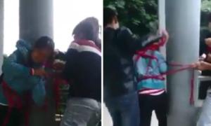 Trò đùa trói bạn nữ vào cột của 4 thanh niên gây phản cảm