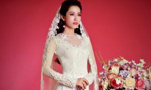 Hoa hậu Phan Thu Quyên e ấp khi diện áo dài cưới