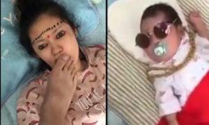 Chồng 'chơi khăm' vợ và con nhỏ khi ngủ