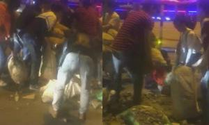 Người Hà Nội cùng thu dọn rác bị đổ ra đường sau trận thắng của U23