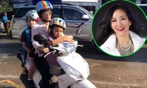 Hồng Nhung tự lái xe máy chở hai con đến trường
