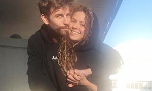 Pique và Shakira ôm nhau ở chỗ rửa xe