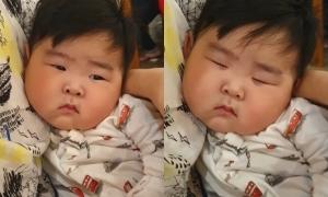 Bé trai má xệ buồn ngủ hút hàng nghìn lượt xem