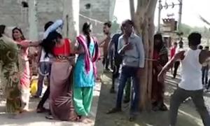 Bị đánh và quấy rối vì giúp họ hàng bỏ trốn với phụ nữ có chồng