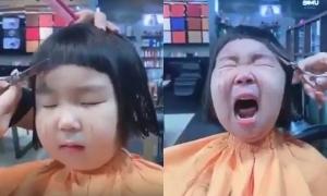 Bé gái gào khóc vì bị cắt tóc kiểu 'nồi úp'
