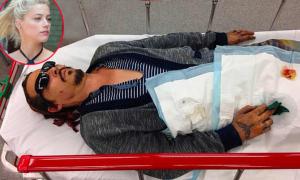 Johnny Depp tung ảnh nằm cáng máu me, cáo buộc vợ cũ bạo hành