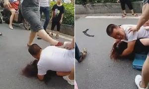 Chồng nằm lên người nhân tình che chắn khi vợ đánh ghen