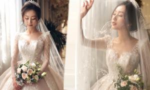 Cô dâu chọn váy cưới tôn vẻ đẹp mong manh