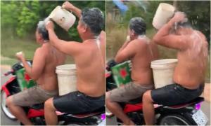 Vừa chạy xe máy vừa tắm