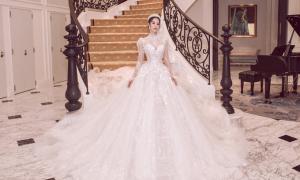 Tiểu Vy 'hóa' cô dâu với váy cưới hoàng gia