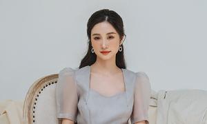 Jun Vũ hóa tiểu thư với váy công sở