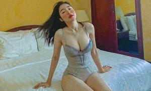 Ảnh sao 27/9: Elly Trần khoe body 'đồng hồ cát'