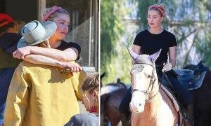 Amber Heard học cưỡi ngựa với người tình đồng giới