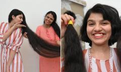 Thiếu nữ tóc dài nhất thế giới cắt ngắn sau 12 năm