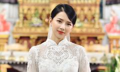 Vợ Phan Mạnh Quỳnh diện áo dài đính 8.000 viên Swarovski